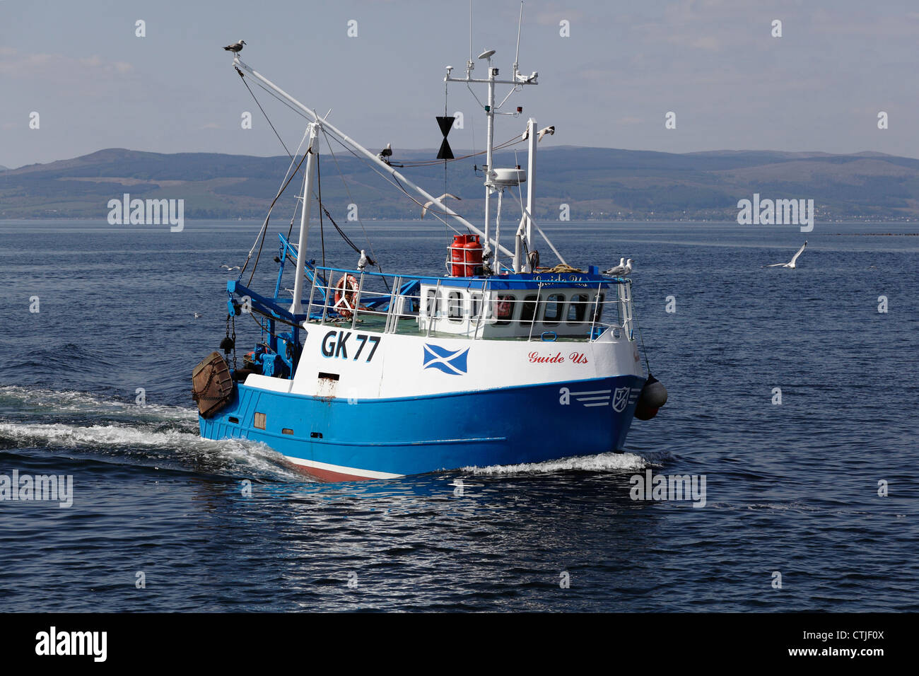 Small fishing boat Guide Us sailing in the Firth of Clyde, Ayrshire, Scotland, UK - Stock Image