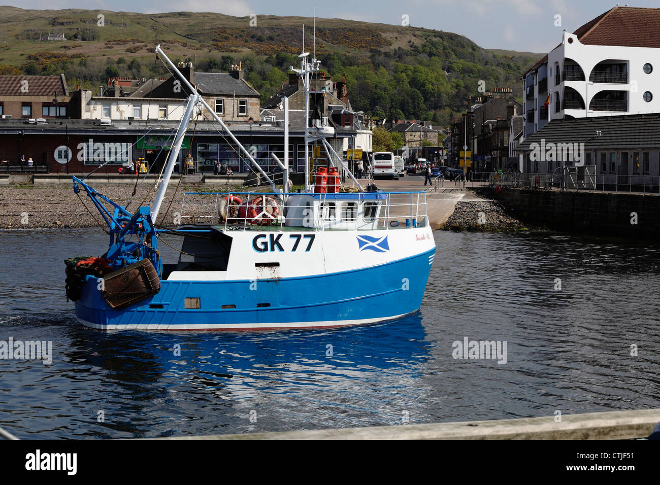 Small fishing boat Guide Us approaching Largs Harbour in ...