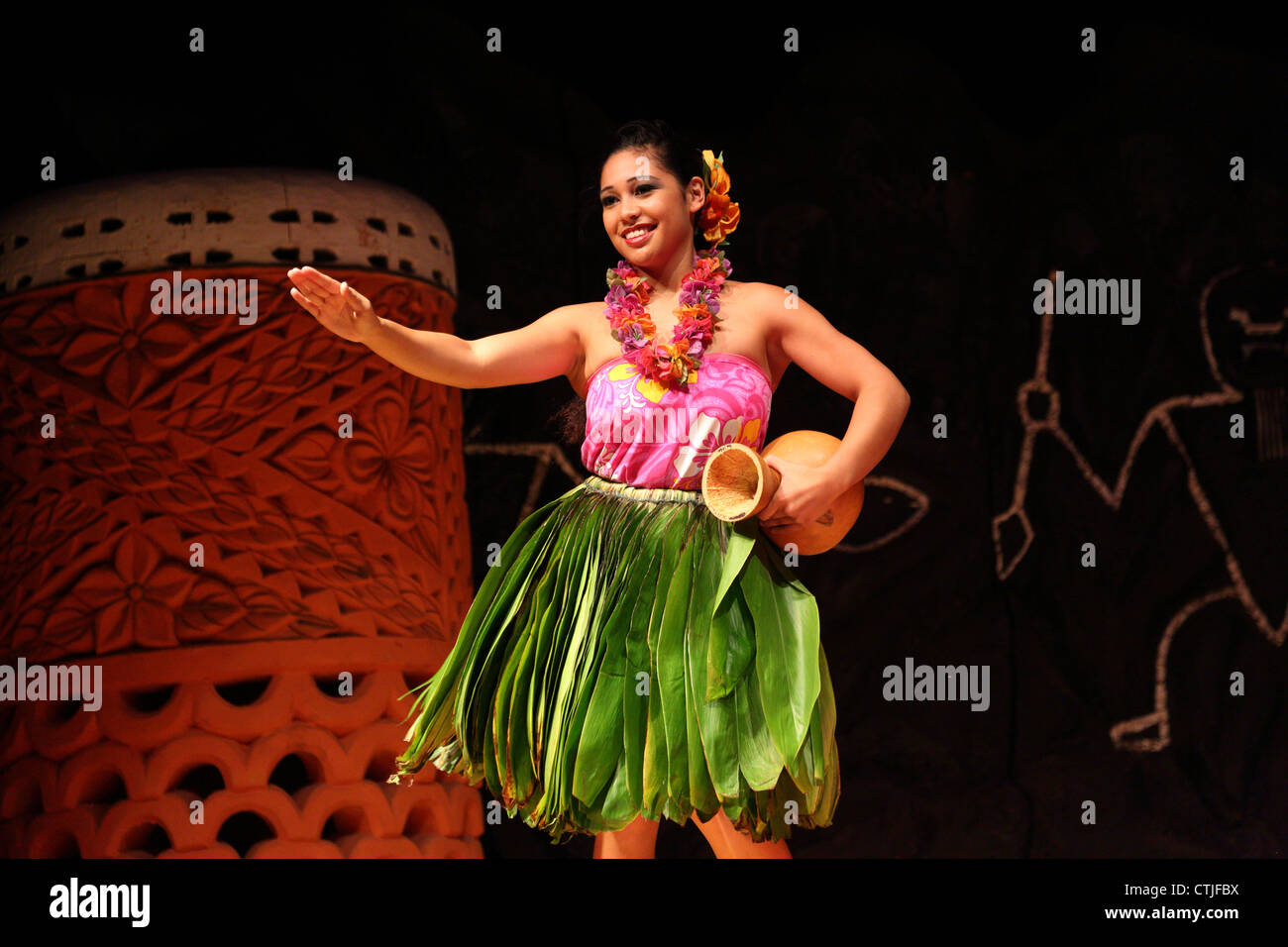Hula dancer at Hawaiian Luau Stock Photo