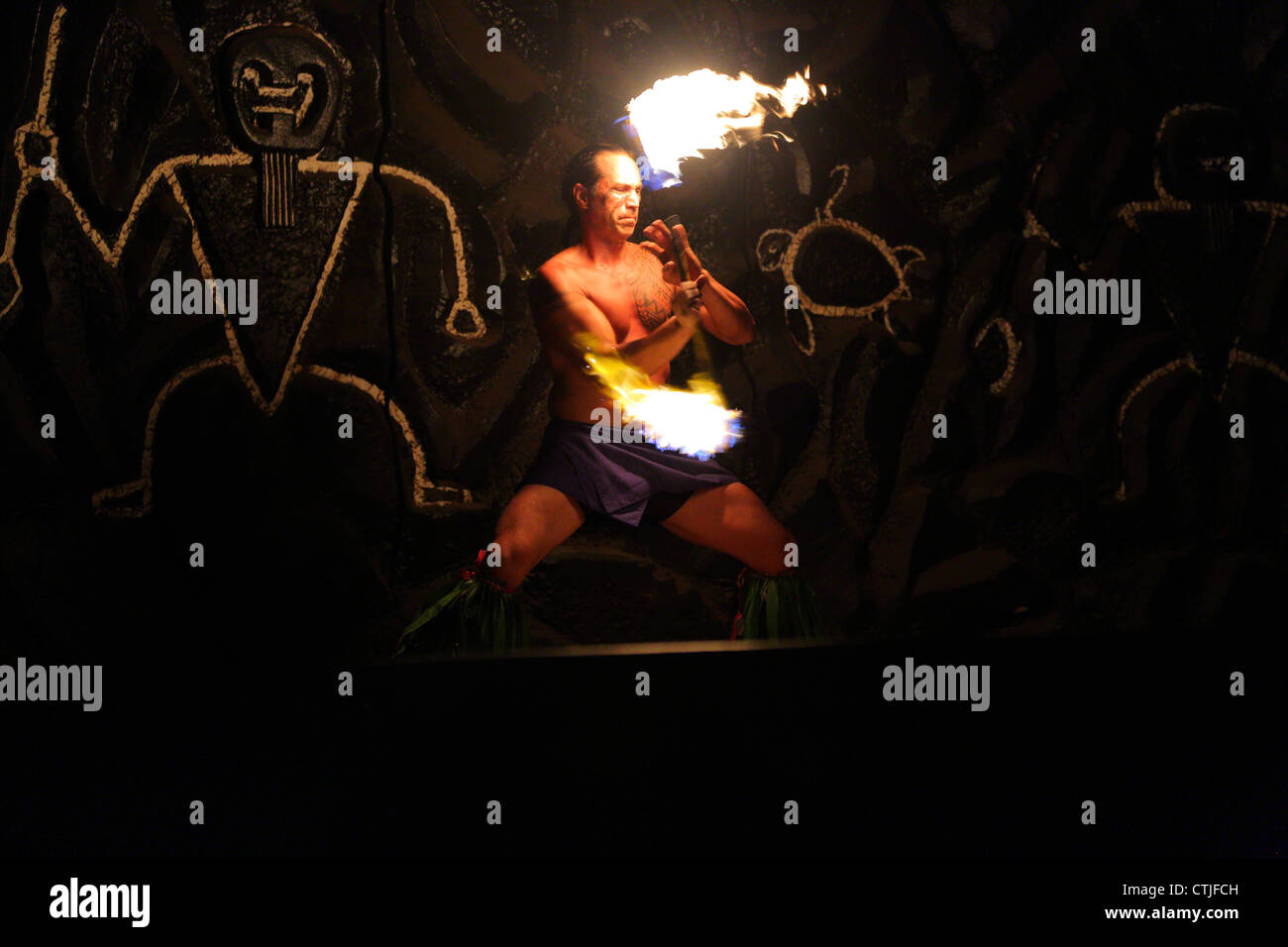 Fire performer at Hawaiian Luau - Stock Image