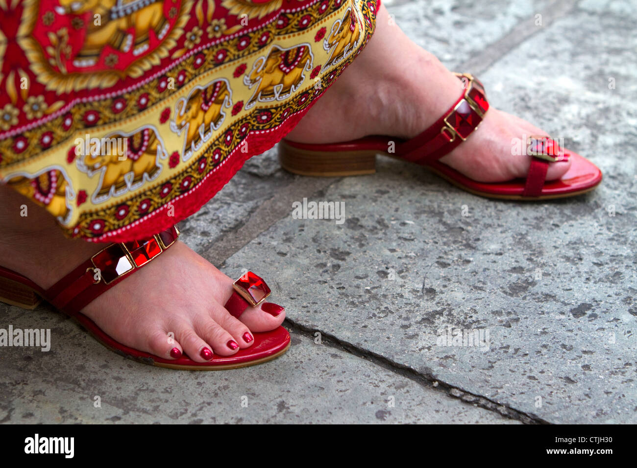 75afe937106b79 Woman wearing red jeweled sandals at the Temple of the Emerald Buddha at  the Grand Palace