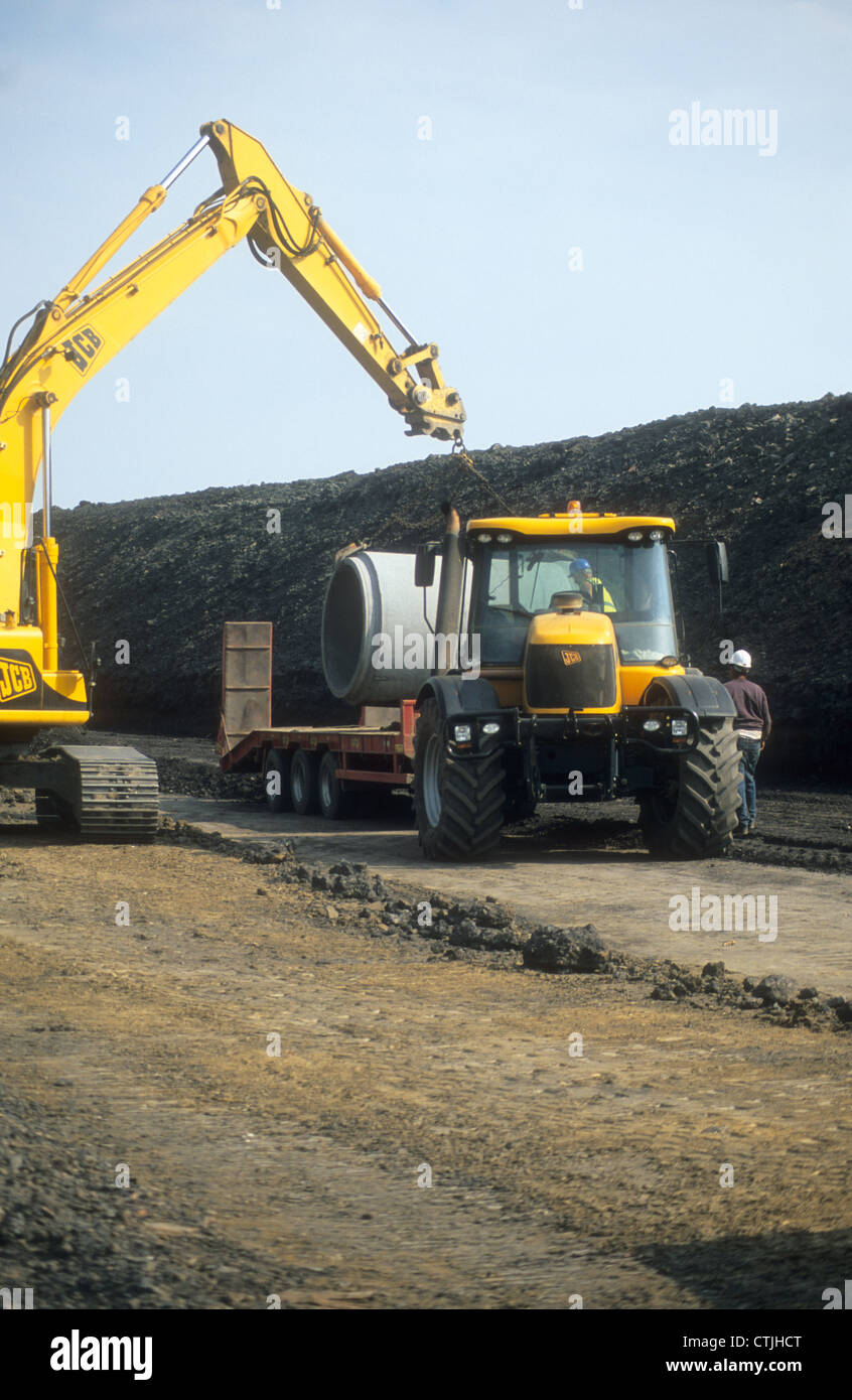 JCB-3220 Fastrac Construction Vehicle delivering drainage piping upon a land redevelopment project in Northern England. Stock Photo