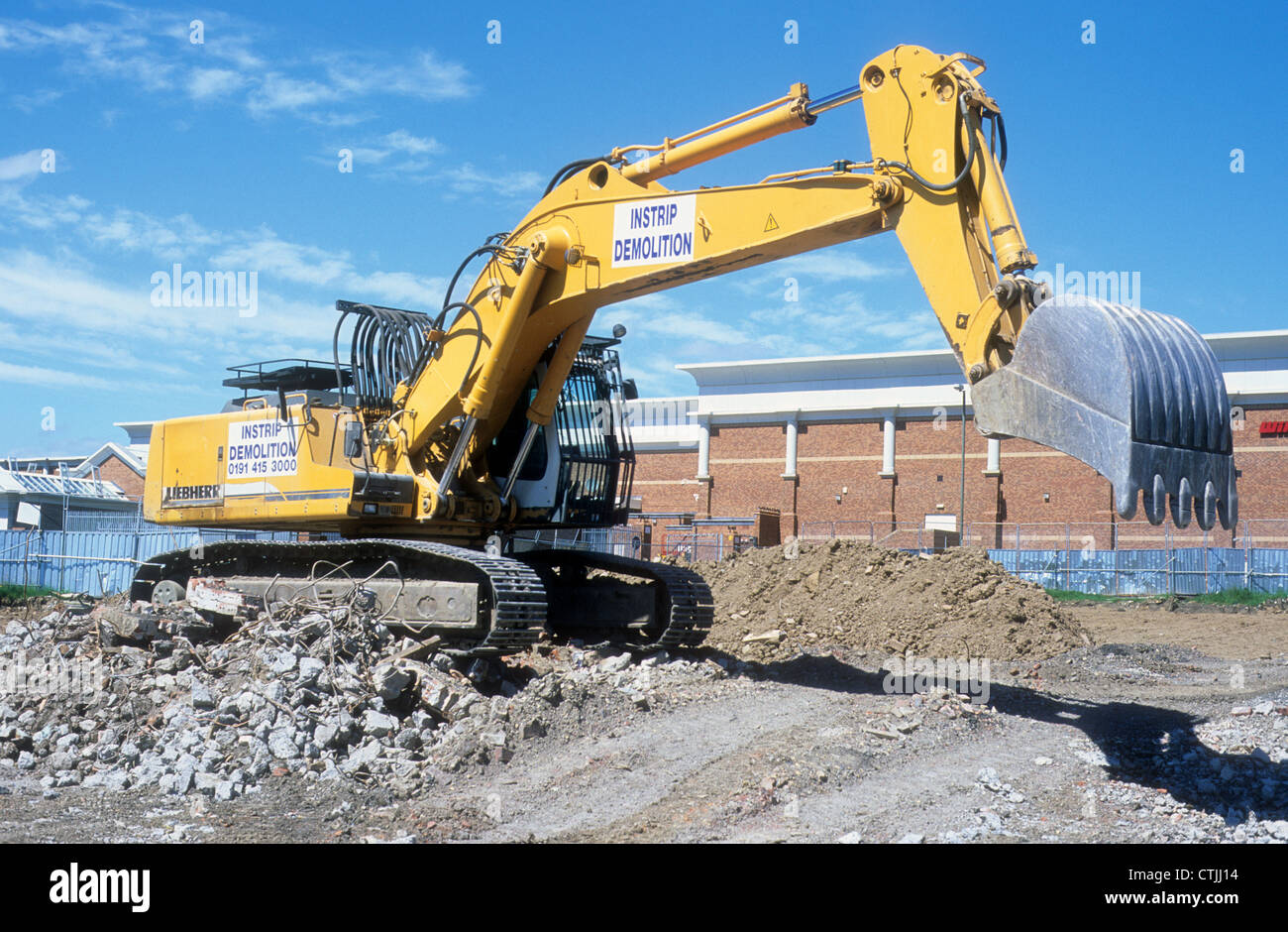Liebherr-360 Excavator stationary upon a constructions site in Northern England. - Stock Image