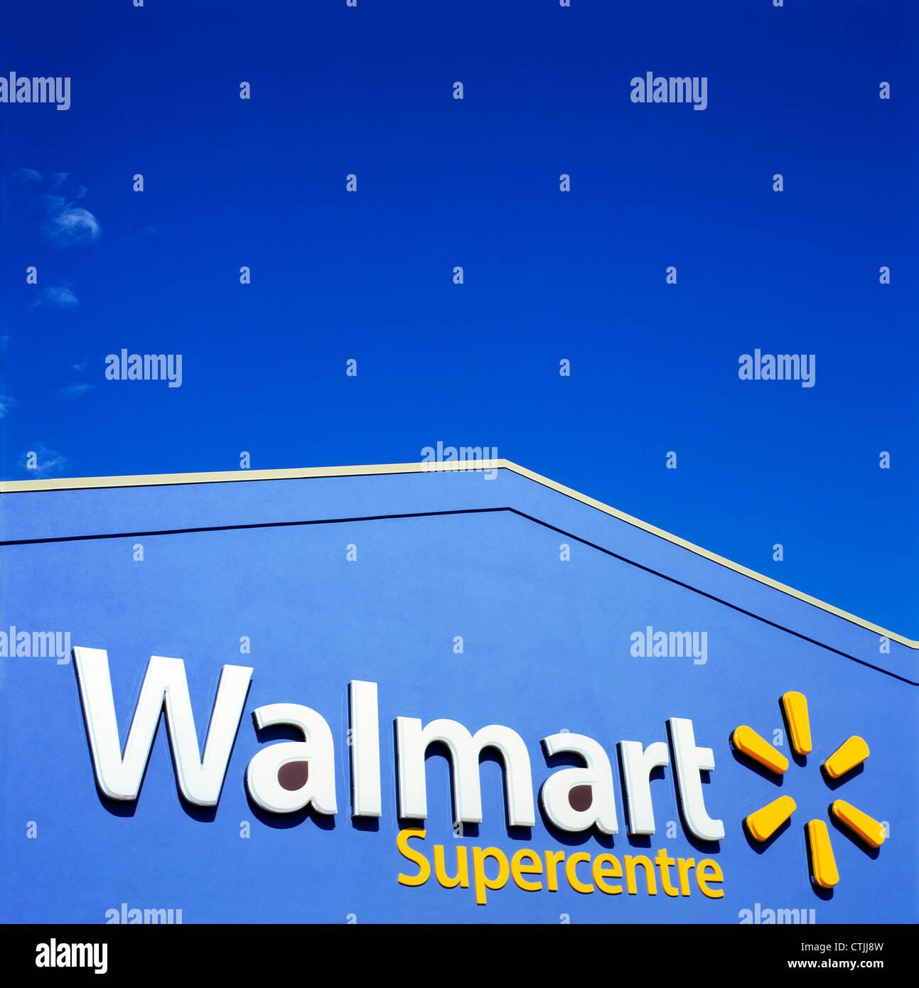 Walmart supercentre store exterior sign against a blue sky Ontario Canada  KATHY DEWITT - Stock Image