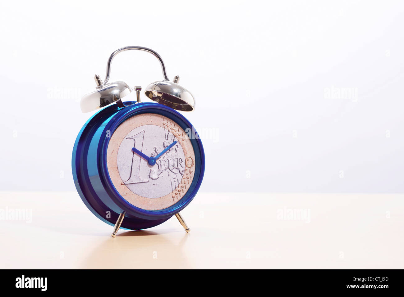 EU Europe euro coin on an alarm clock - Stock Image