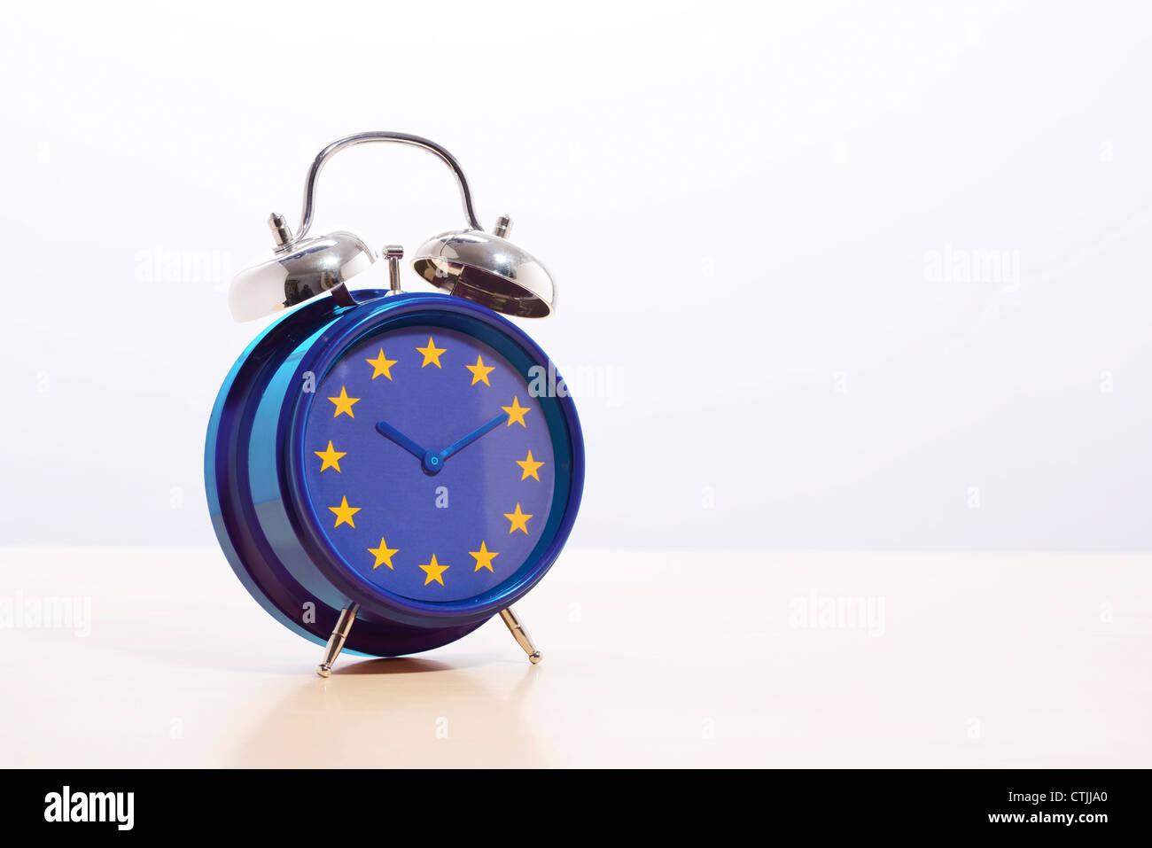 EU Europe flag on an alarm clock - Stock Image