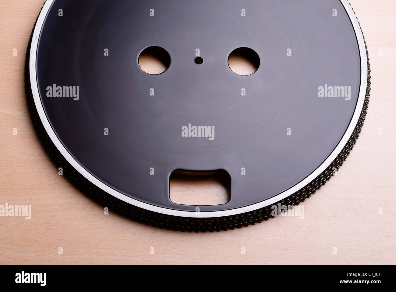 Hidden face design on a record turntable - Stock Image