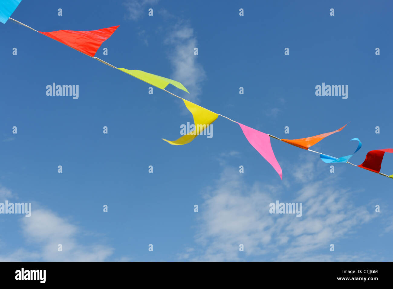 Colourful bunting and blue sky - Stock Image