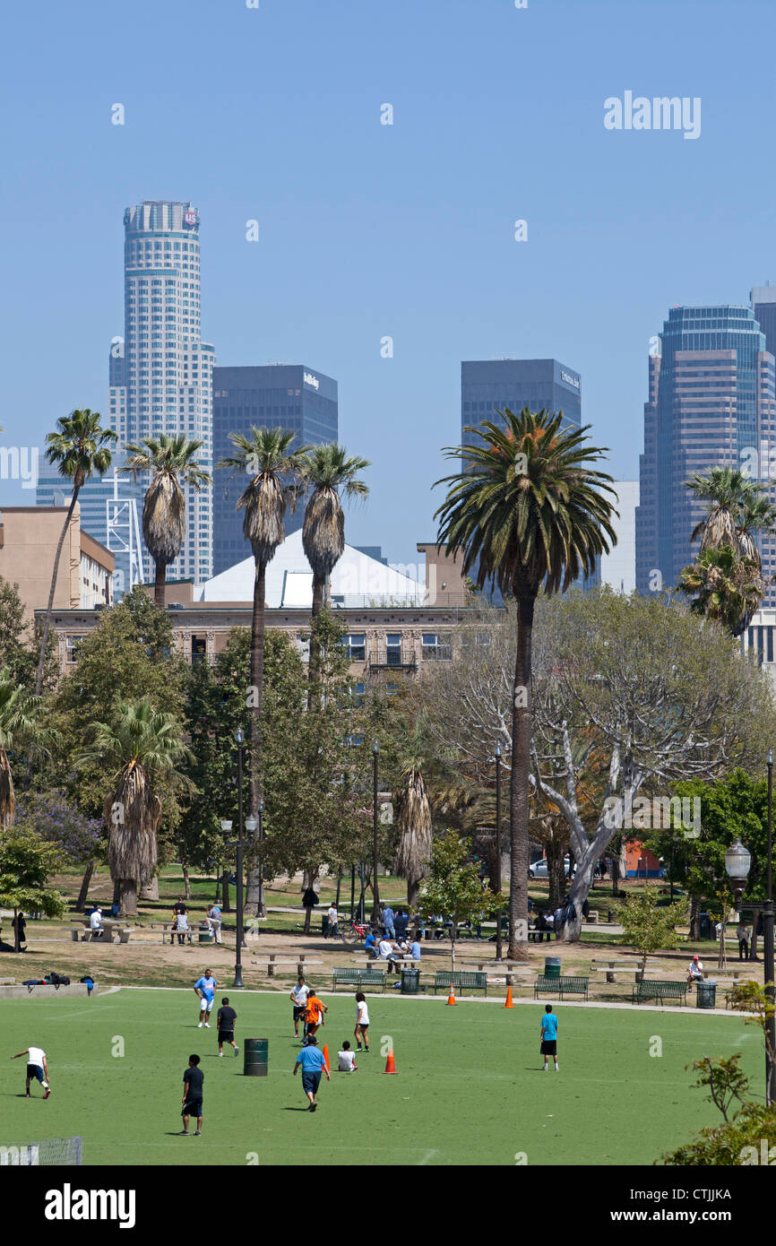 Los Angeles, California - A soccer game in MacArthur Park, with downtown Los Angeles in the background. - Stock Image