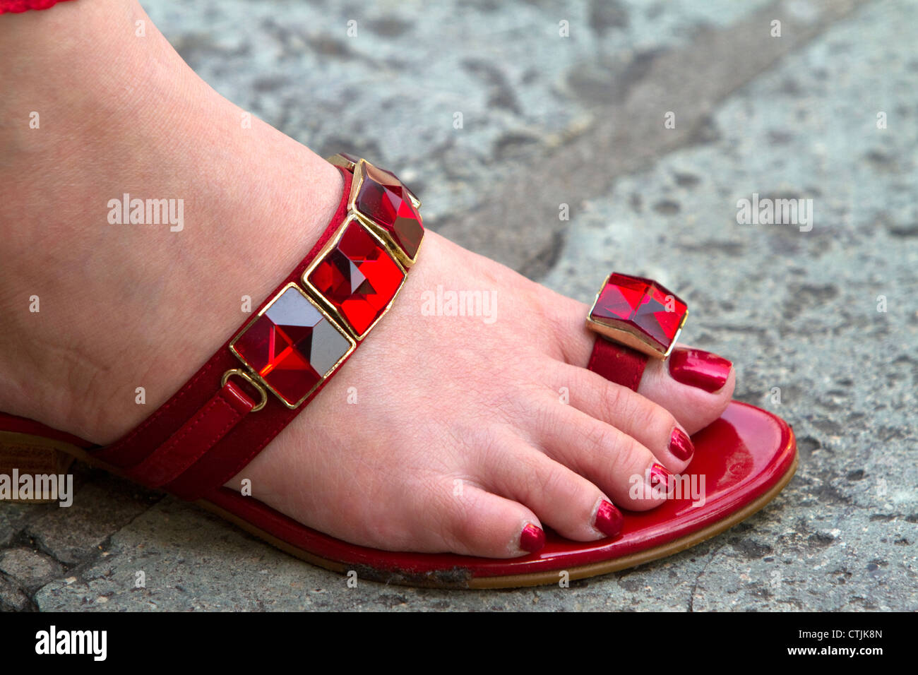 c9284fb629e761 Woman wearing a red jeweled sandal at the Temple of the Emerald Buddha at  the Grand