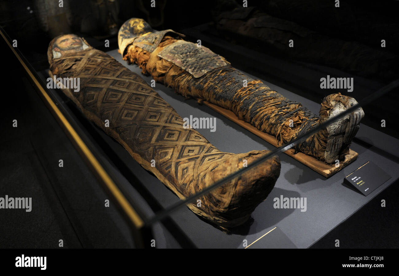 Egyptian mummies. On the right, mummy dated c. 300 B.C. On the left, mummy dated c. 50 A.D. - Stock Image