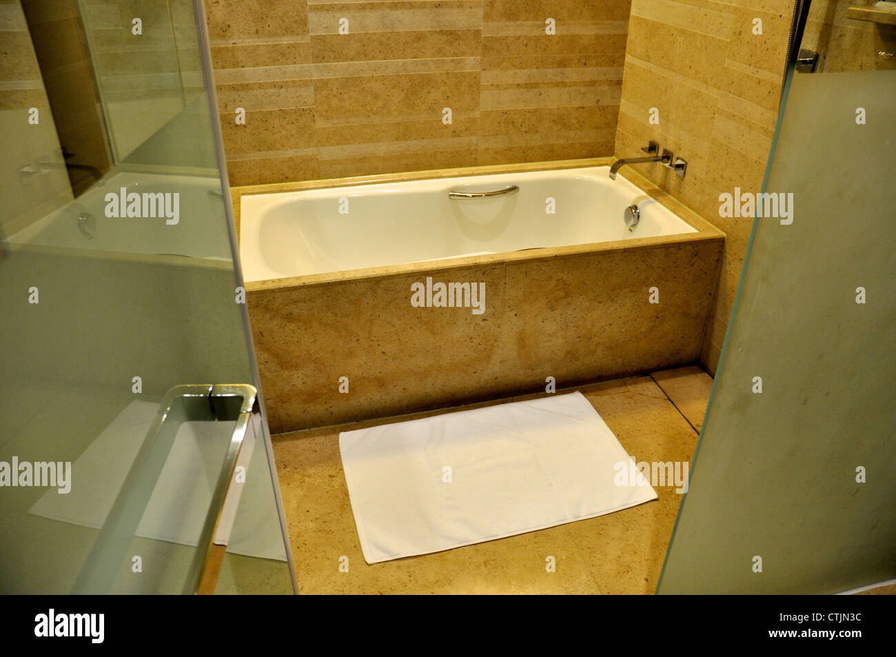 an empty bathroom in a luxury hotel  - Stock Image