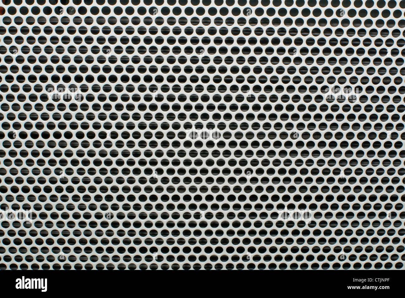 Closeup of a metal gray textured mesh - Stock Image