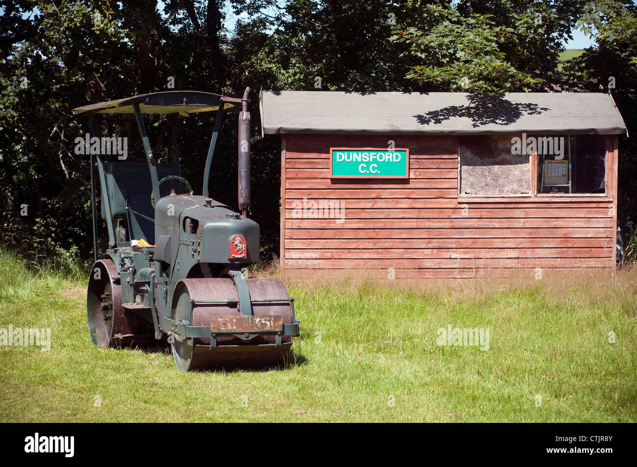 clubhouse, cottage, country, course, cricket, field, football, forest, garden, golf, grass, green, grounds, home, - Stock Image
