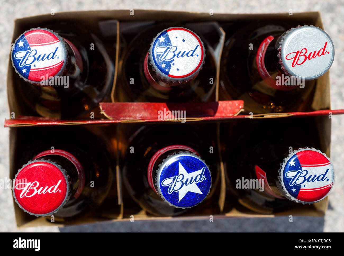 A Six Pack of bottles of Budweiser beer with varied caps, USA - Stock Image