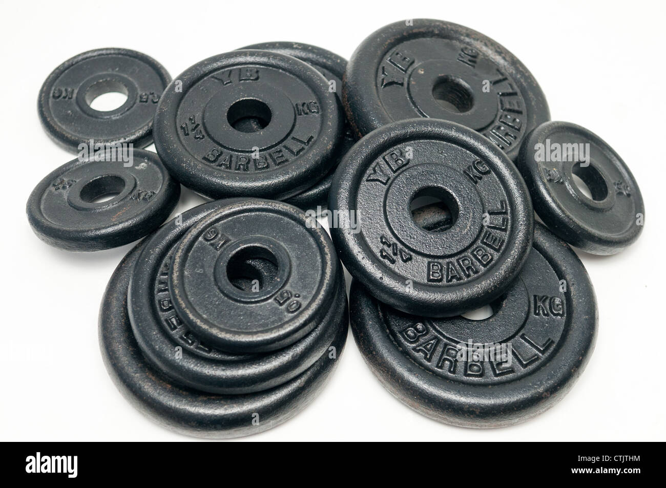 Pile of dumbbell weight discs - Stock Image