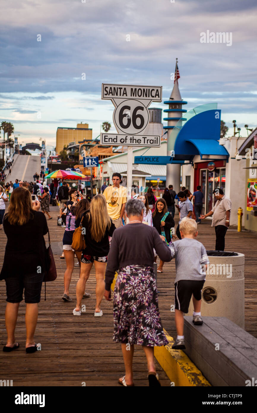 The end of Route 66 on the Santa Monica pier in California with tourists taking photos Stock Photo