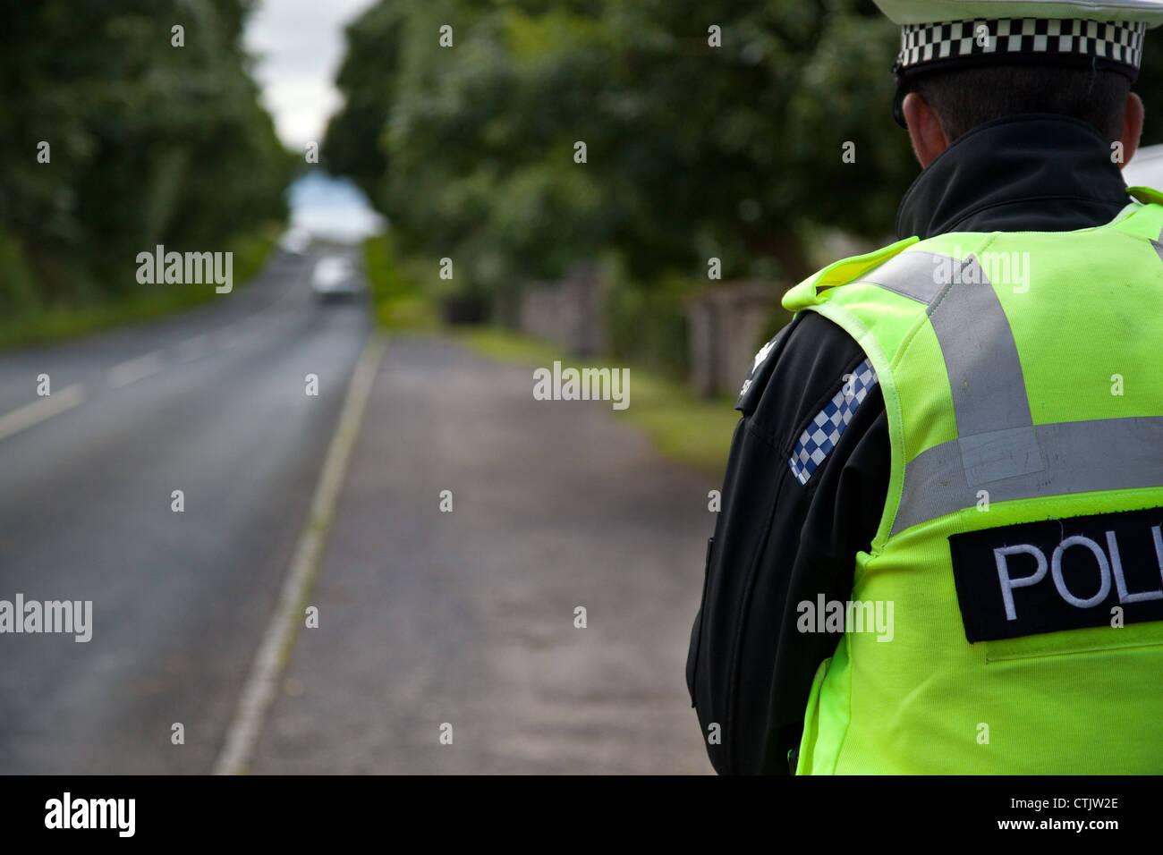 Traffic policeman on speed patrol check duties;  Police Traffic Officer, policing radar gun in North Yorkshire Dales Stock Photo