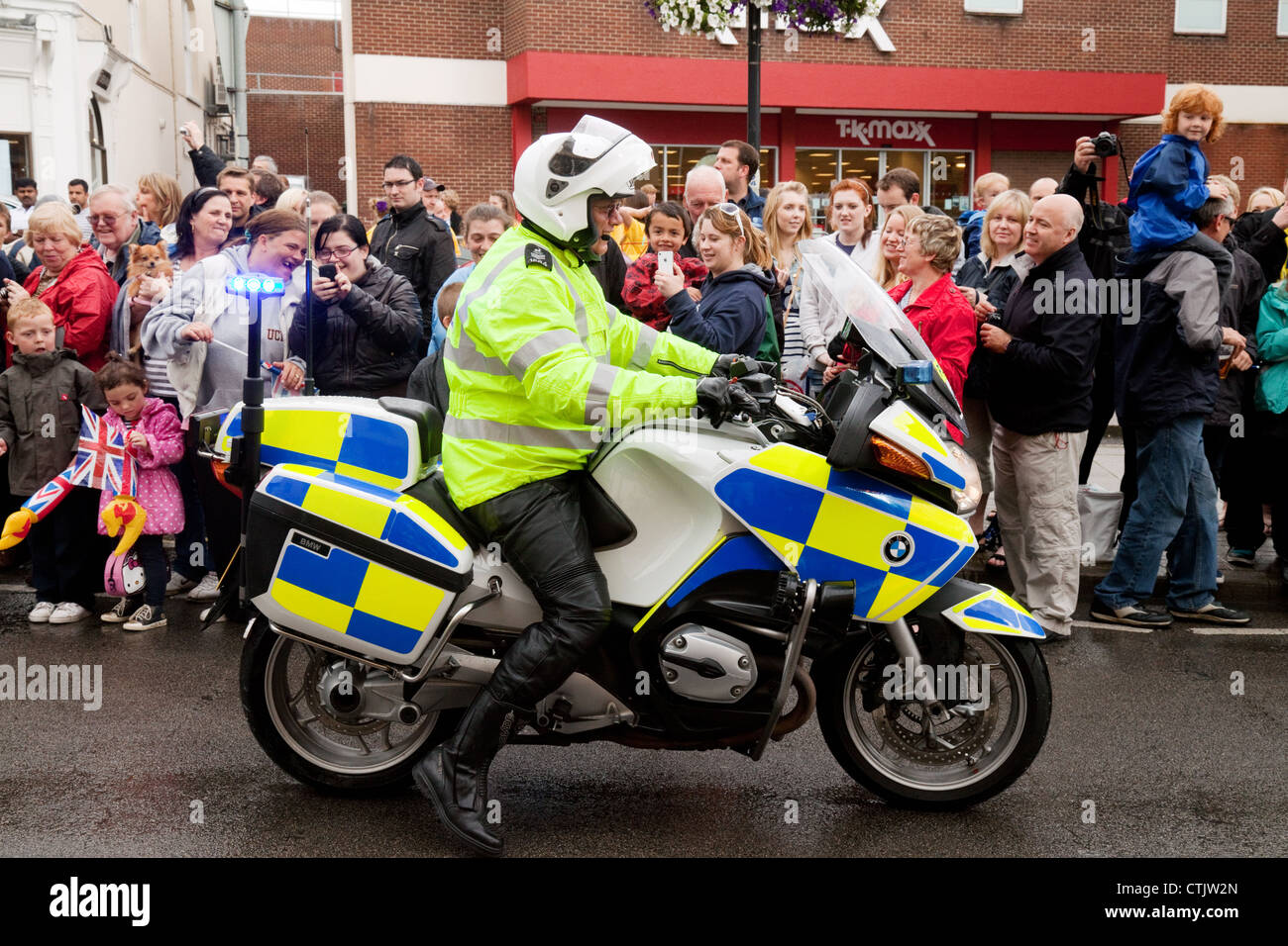 Policeman on motorcycle patrol, 2012 Olympic Torch relay, Newmarket Suffolk UK - Stock Image