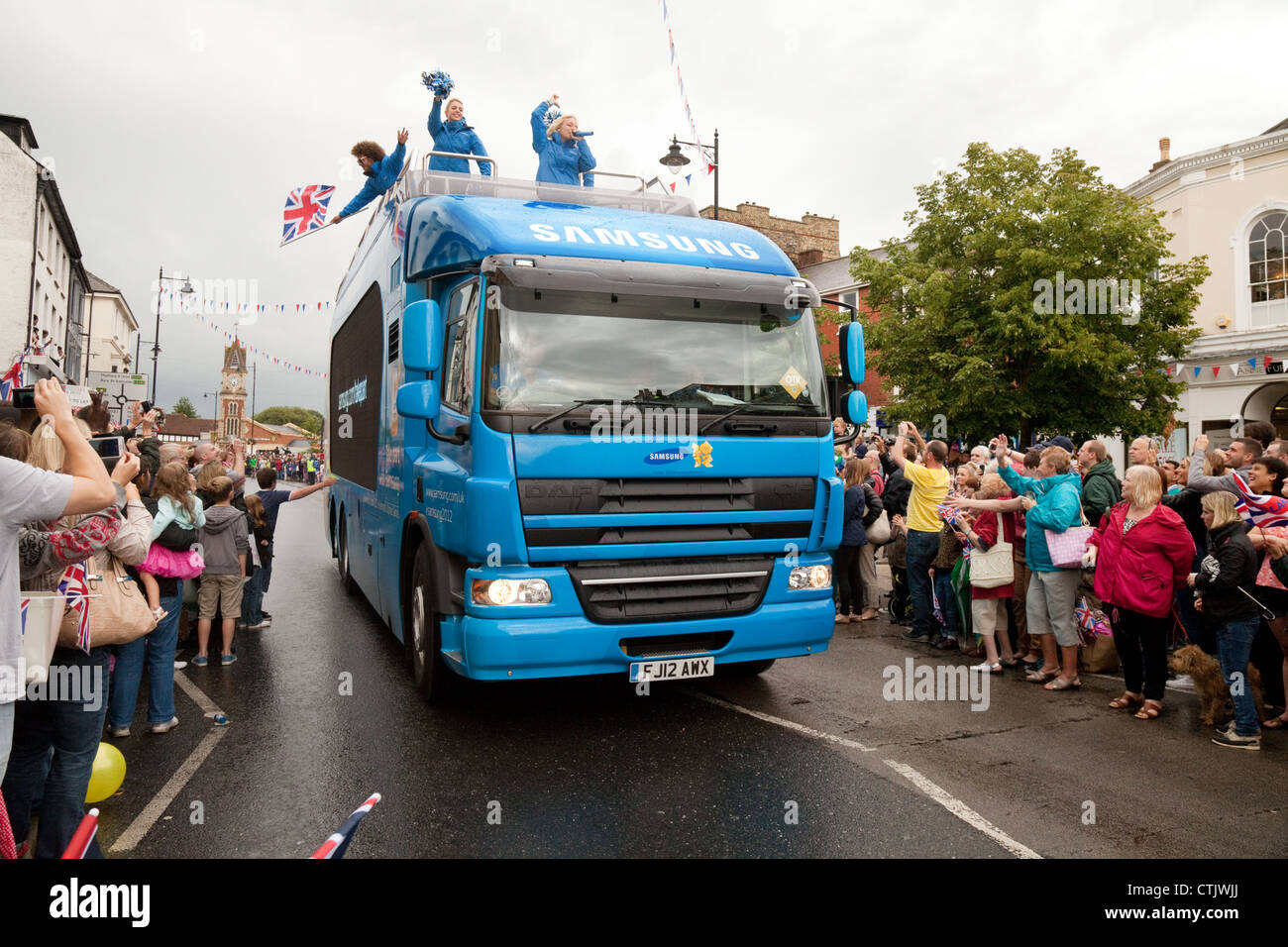 The Samsung 2012 Olympic Sponsor vehicle at the Torch Relay through Newmarket Suffolk East Anglia UK - Stock Image