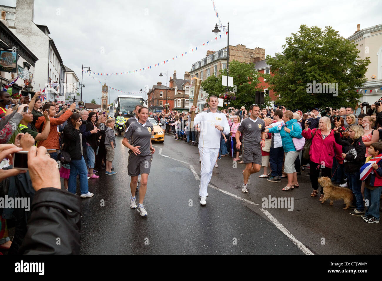 The 2012 Olympic Torch relay, High St,  Newmarket Suffolk East Anglia UK - Stock Image