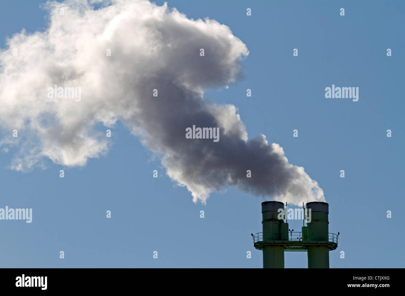 Smoking chimney - Stock Image