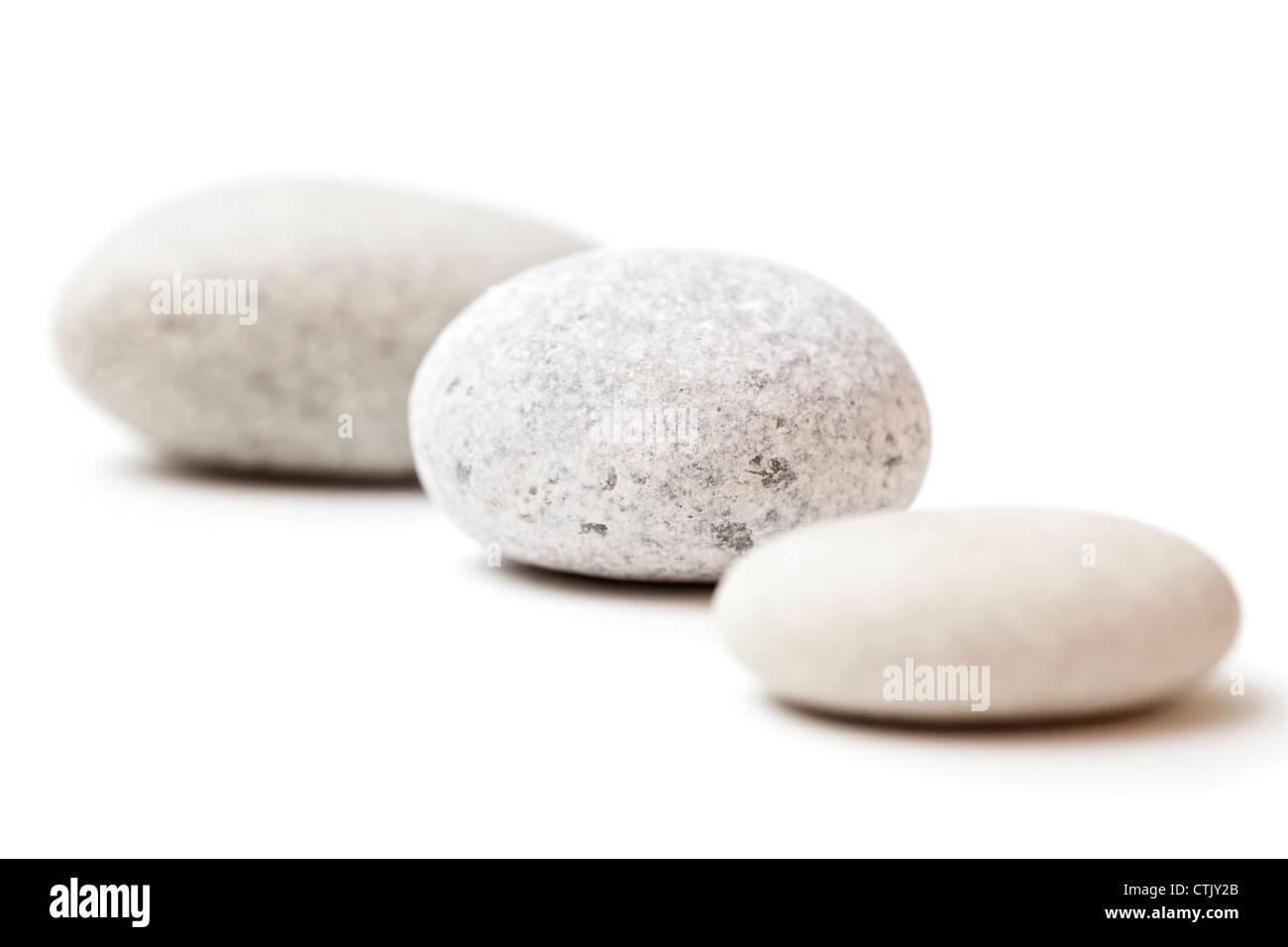 three gray spa stones isolated on white background - Stock Image