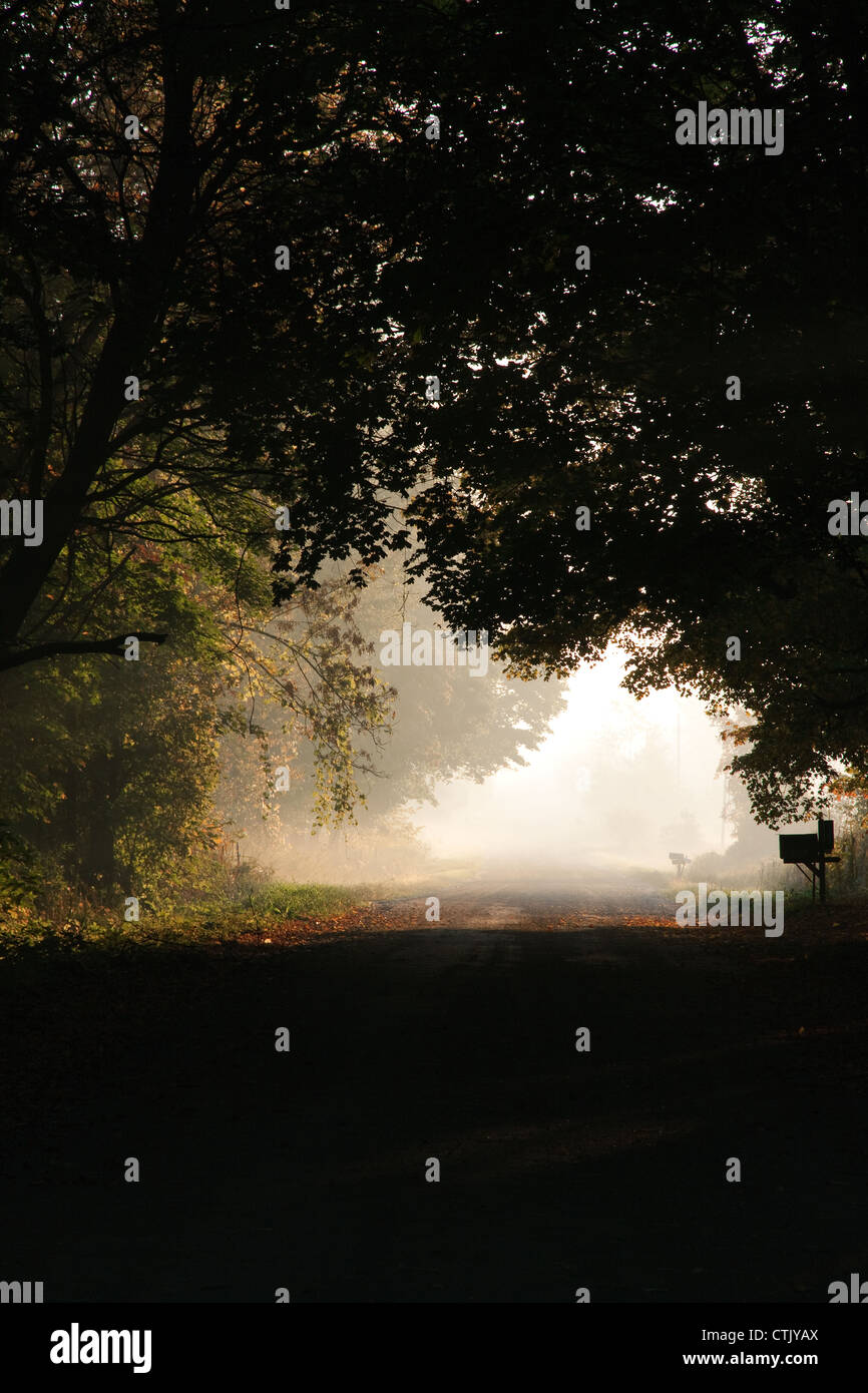Sunrise over country road, USA - Stock Image