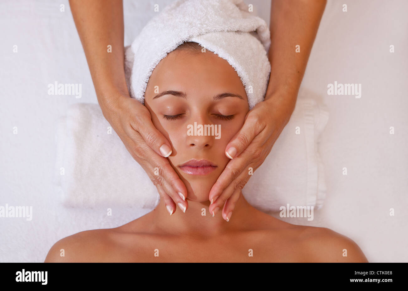 woman getting relaxing head or face massage - Stock Image