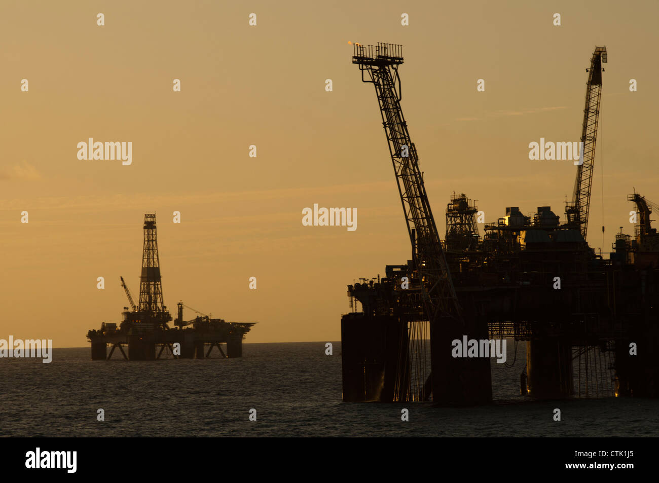 offshore oil rig silhouette during sunset/sunrise time