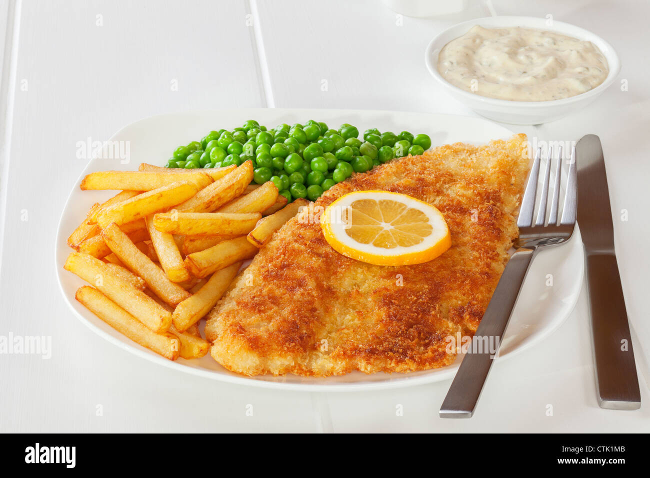 Crumbed Fish with Chips, Peas and Tartare Sauce - Stock Image
