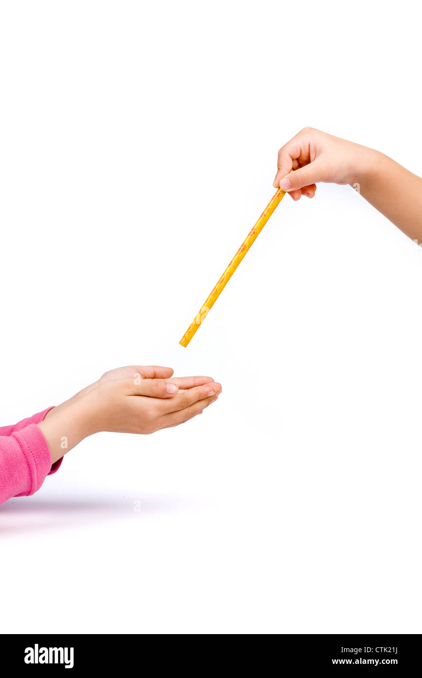 handing over a pencil, learning concept - Stock Image