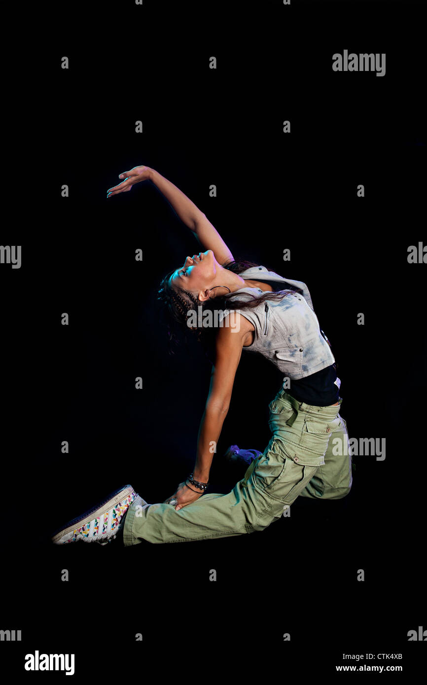 beautiful dancer sports model against black background studio lighting - Stock Image