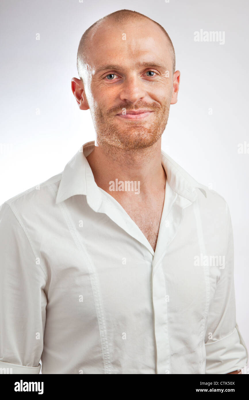 headshot white shirt middle aged relaxed professional in studio - Stock Image