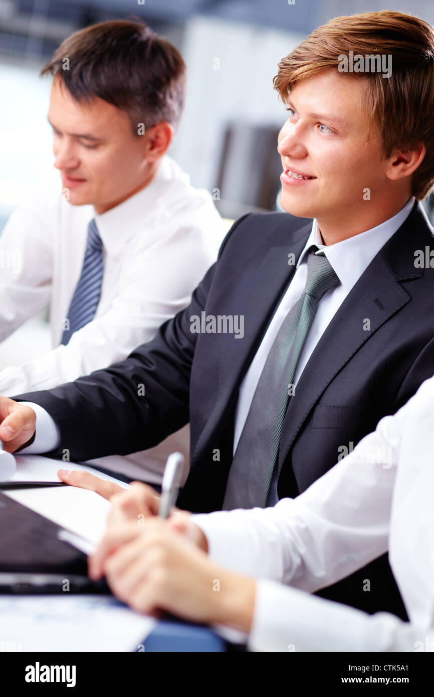 Vertical shot of a happy guy succeeding in business - Stock Image