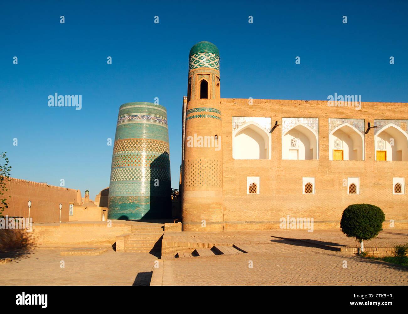 Madrasas and minoret in Khiva, Uzbekistan - Stock Image
