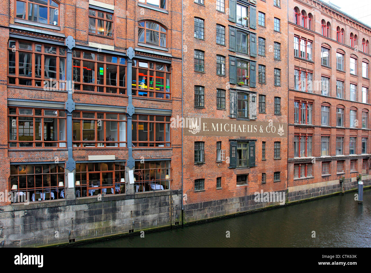 Germany, Hanseatic City Hamburg, Brick building on a Fleet - Stock Image