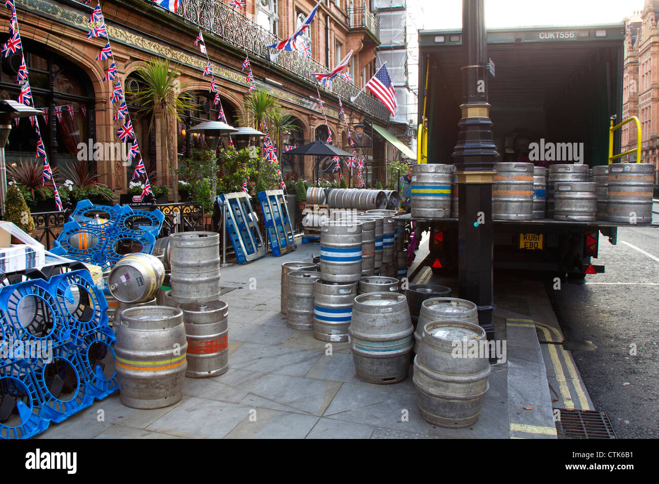 Kegs of Beer Being Delivered to London Pub - Stock Image