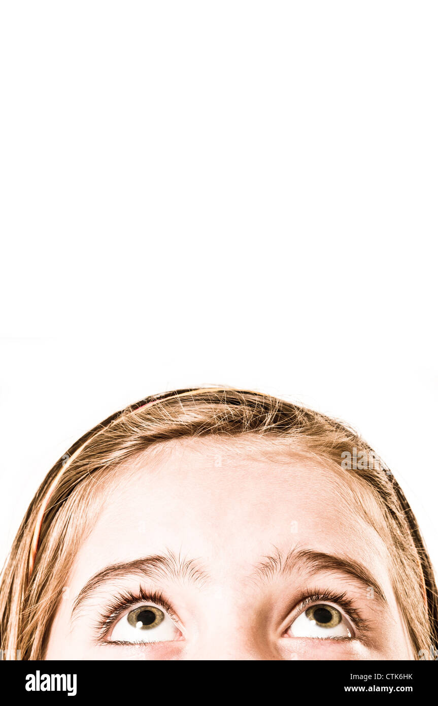 girl looking up worried - Stock Image