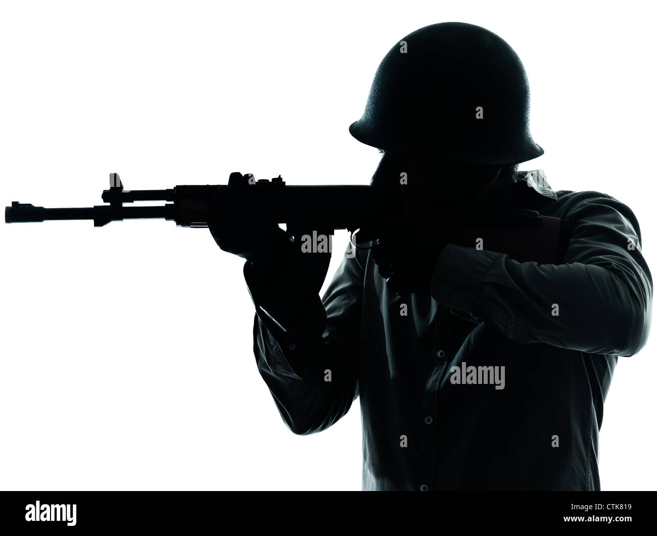 one caucasian army soldier man shooting on studio isolated on white background - Stock Image