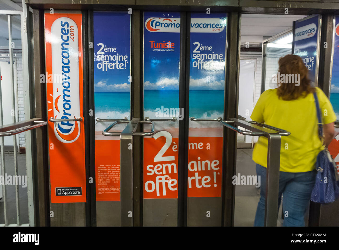 Paris, France, French Holiday Travel Advertising Posters in Paris Metro Exit Doors - Stock Image