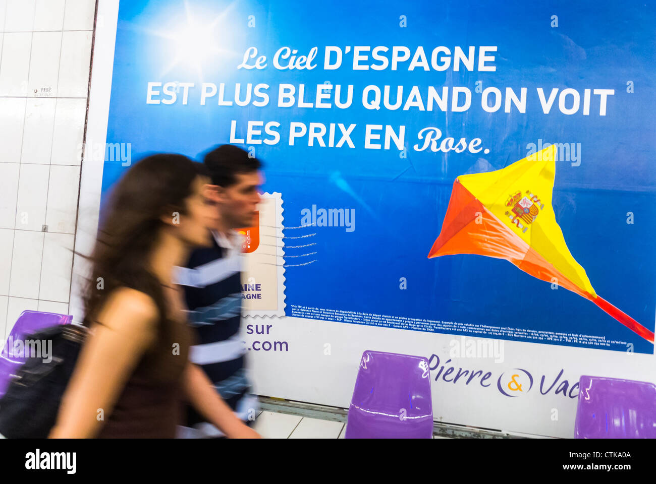 Paris, France, People Walking near French Travel Advertising Posters in Metro Quay, Spain - Stock Image
