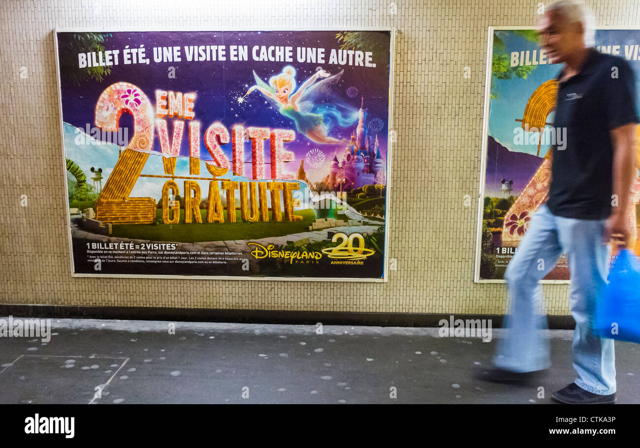 Paris, France,  French Travel Advertising Posters in Metro Hallway, Disneyland - Stock Image