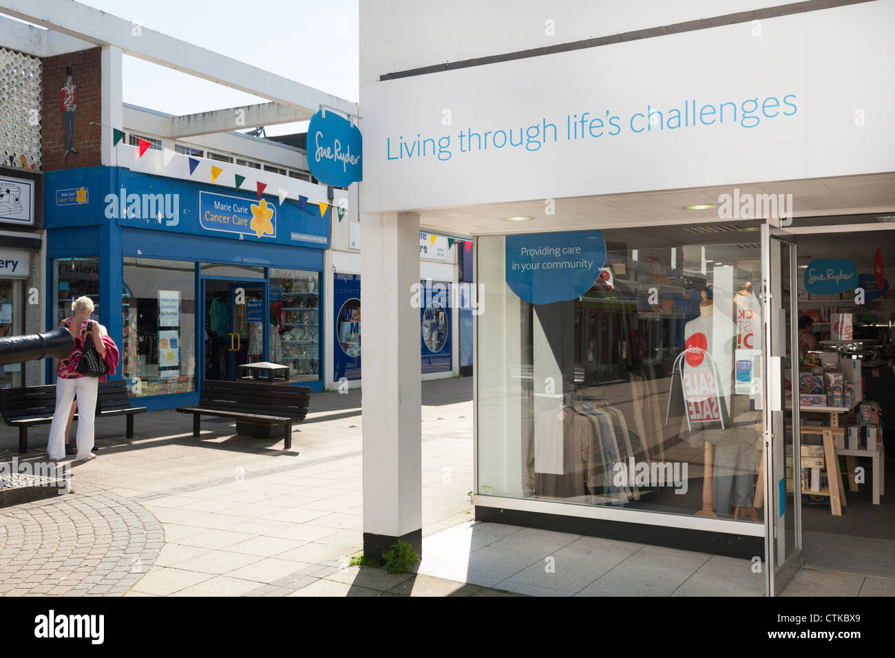 Sue ryder charity shop with Marie Curie Charity shop in high street arcade - Stock Image