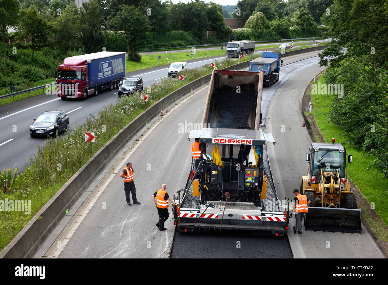 Autobahn, motorway A40,  Installation of a new asphalt surface on the carriageway of Duisburg. Germany. - Stock Image
