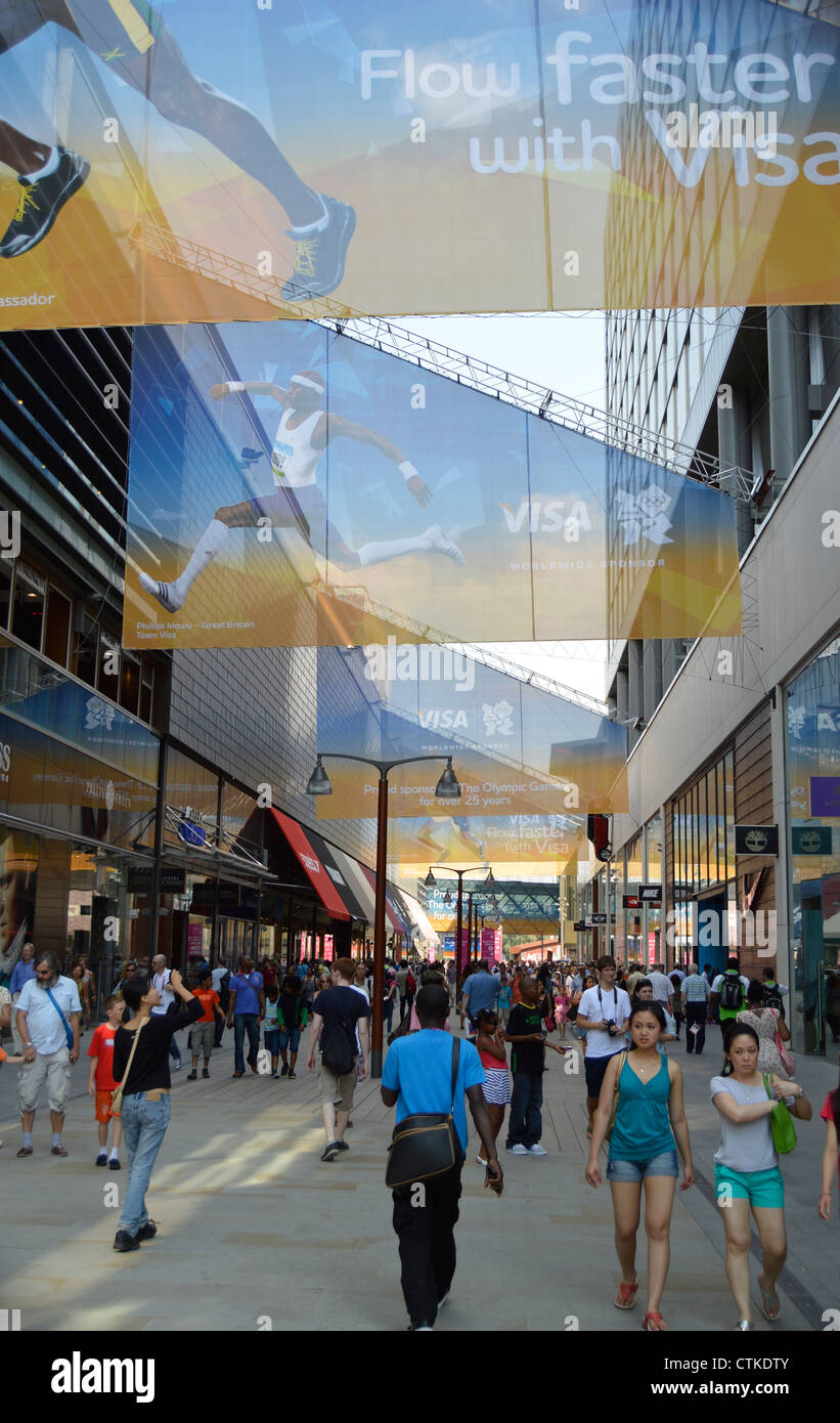 The Street at Westfield Shopping Centre, Stratford – with Olympic sponsor, VISA, banners – the entrance to the Olympic - Stock Image