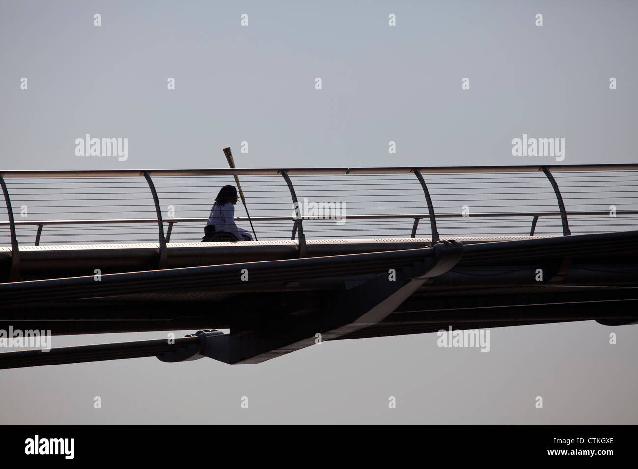 Paralympian Ade Adepitan carried the flame over the Millennium Bridge for London 2012 Olympic - Stock Image