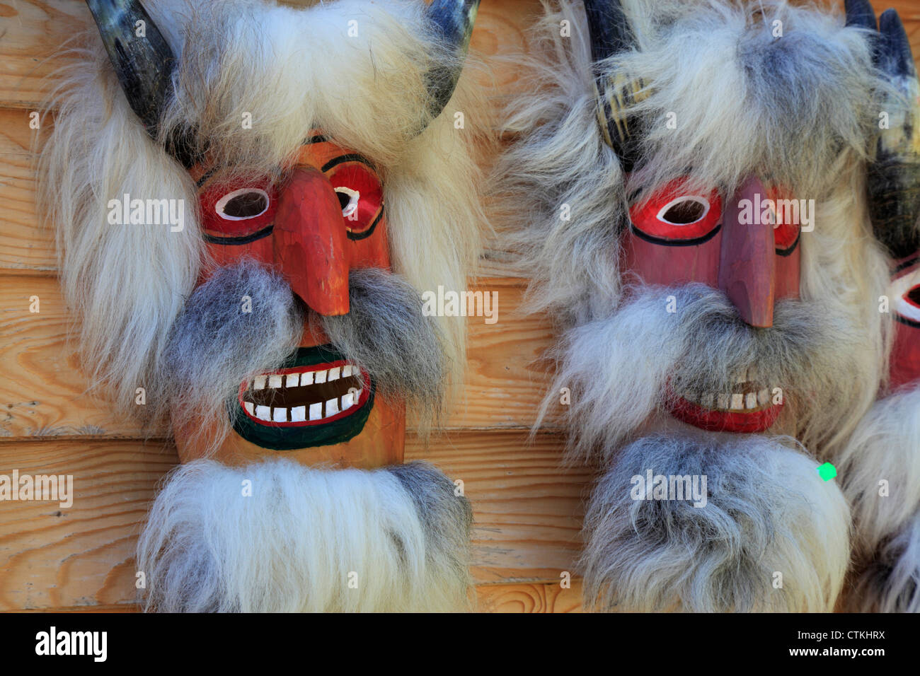 Colorful traditional ritual masks in a gift shop in Bran, Transylvania, Romania - Stock Image