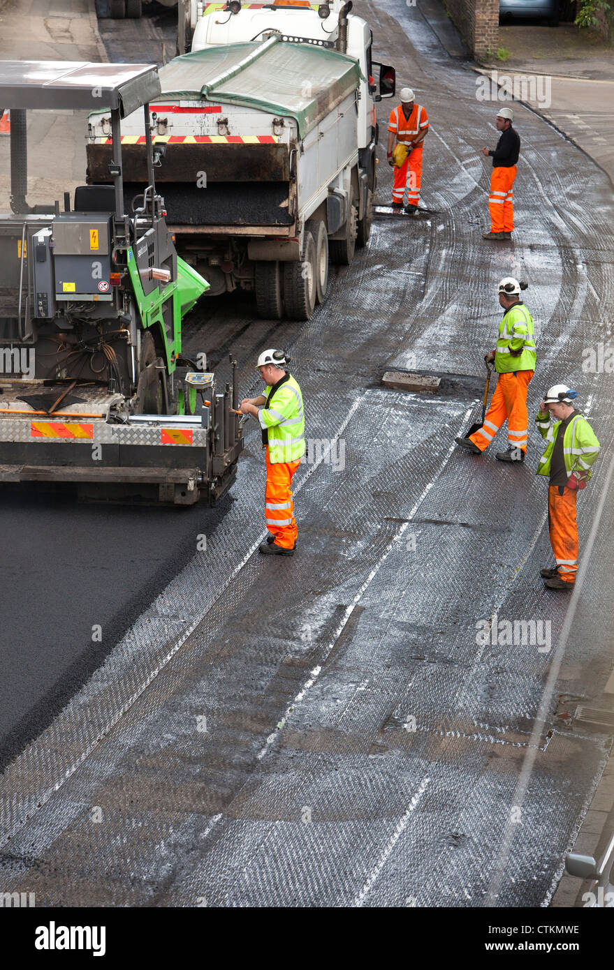 Road being resurfaced with new layer of tarmac asphalt - Stock Image