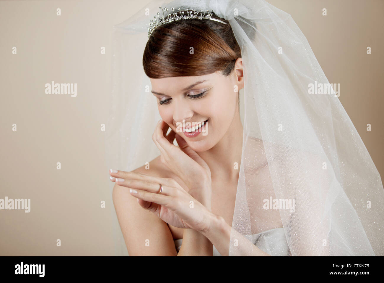 A young bride looking at her wedding ring Stock Photo